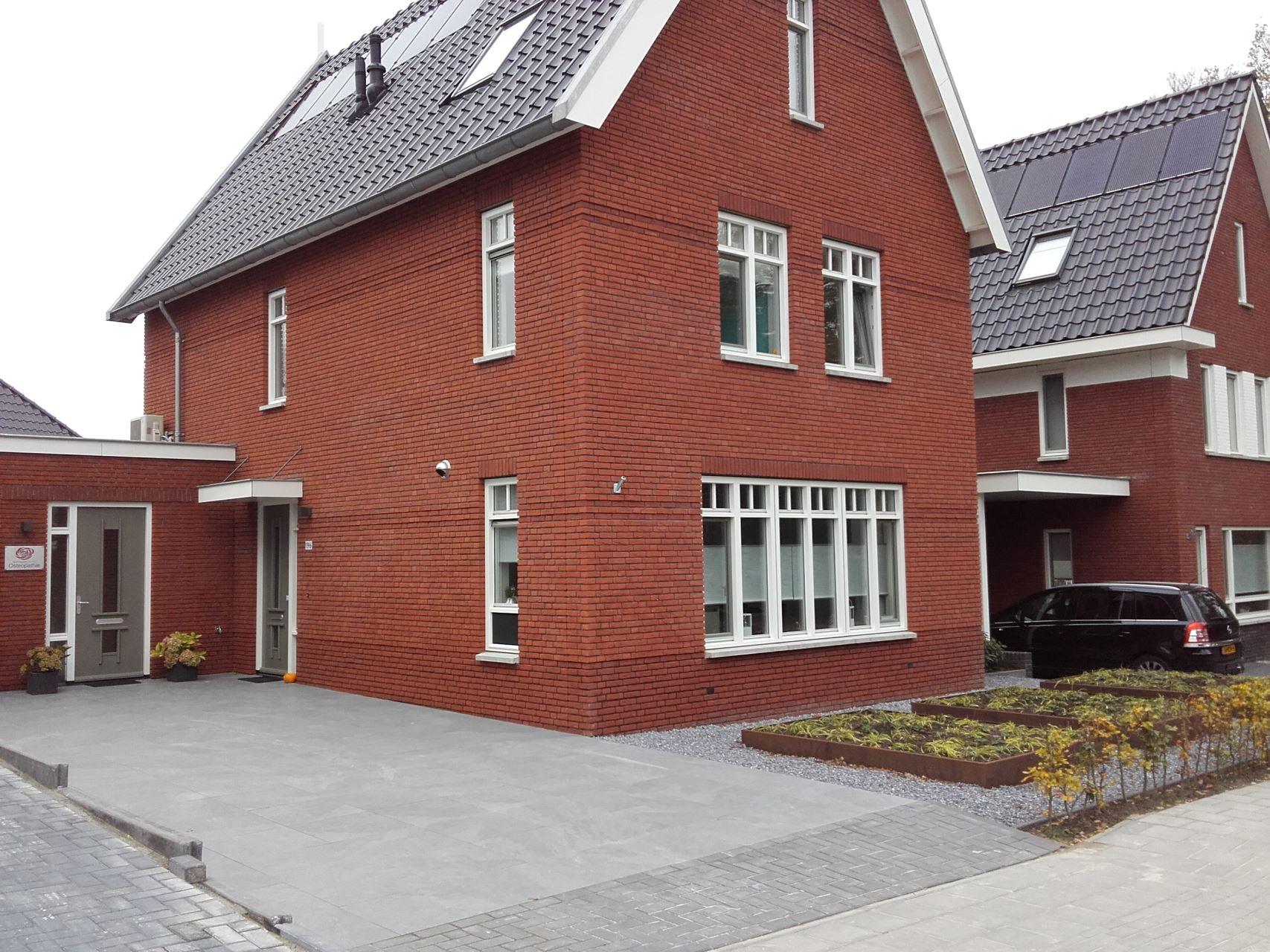 Aanbouw praktijkruimte aan huis
